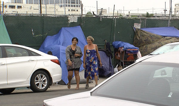 Cindy Bautista (left), who lived for four years in a tent...