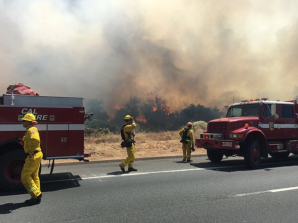 Firefighters battle the Jennings fire near Interstate 8 and Old Highway 80 in...