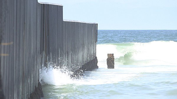 The U.S.-Mexico border fence extends into the Pacific Ocean at Imperial Beach...