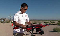 An Action Drone employee prepares to launch a d...