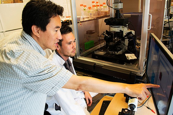 Byungkook Lim (left), associate professor of neurobiology, and Daniel Knowlan...