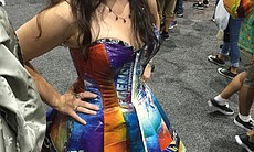 A woman shows off her dress made with Comic-Con...