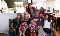 Daliya Ail, center, and her husband, Salim Musa, pose with their six children...