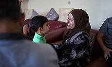Mariam, Mohamad Abdullah's wife, smiles at one ...