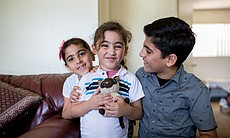 Three of Mohamad Abdullah's children smile for ...