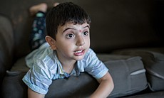 One of Mostafa Inezan's sons plays on the couch...