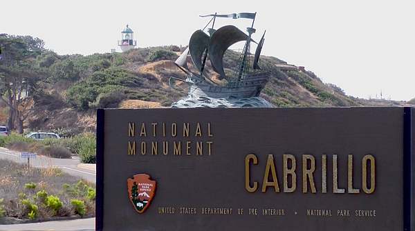 A sign for Cabrillo National Monument sits at the entranc...