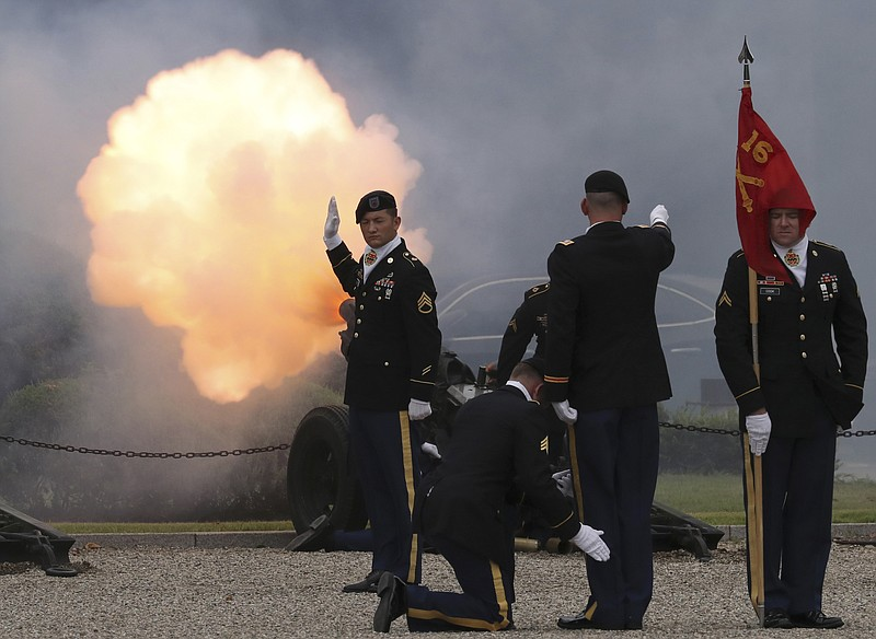 U.S. soldiers fire a salute during a change of command and change of responsi...