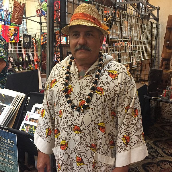Johnny Kunkel, from San Diego, poses for a photo at Tiki Oasis, Aug. 12, 2017.