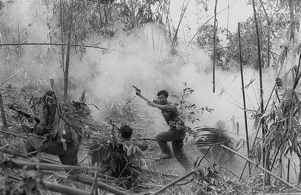 North Vietnamese Army officer leads an attack on South Vietnamese forces. Lao...