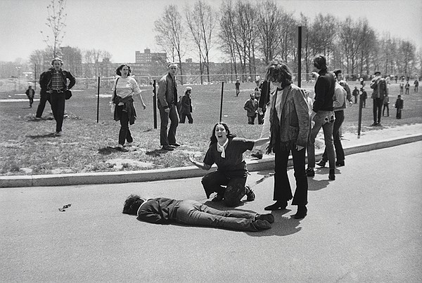Mary Ann Vecchio kneels over the body of fellow student J...