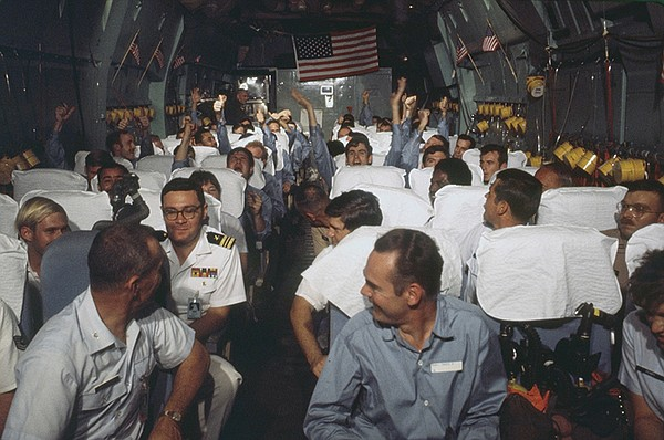 Newly released POWs rejoice on a C-141 plane during Operation Homecoming, 1973.