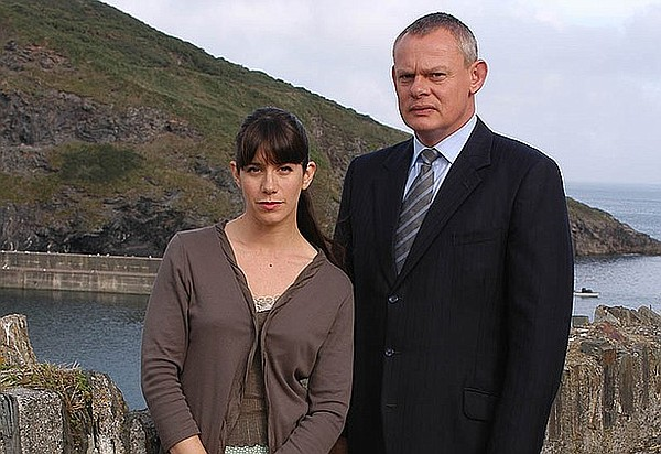 Caroline Catz as Louisa Glasson, and Martin Clunes as the brash doctor Martin...