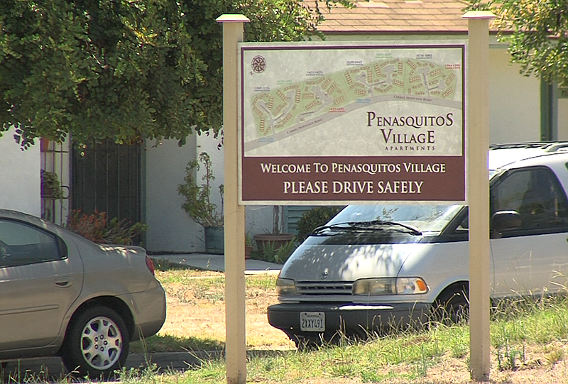 The entrance sign to the Penasquitos Village housing development in Rancho Pe...