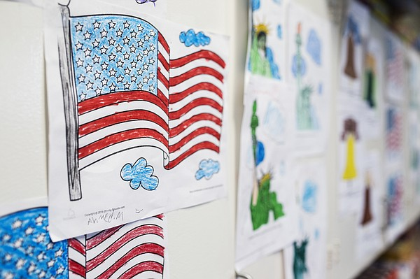 Colored drawings of the American flag and the Statue of L...