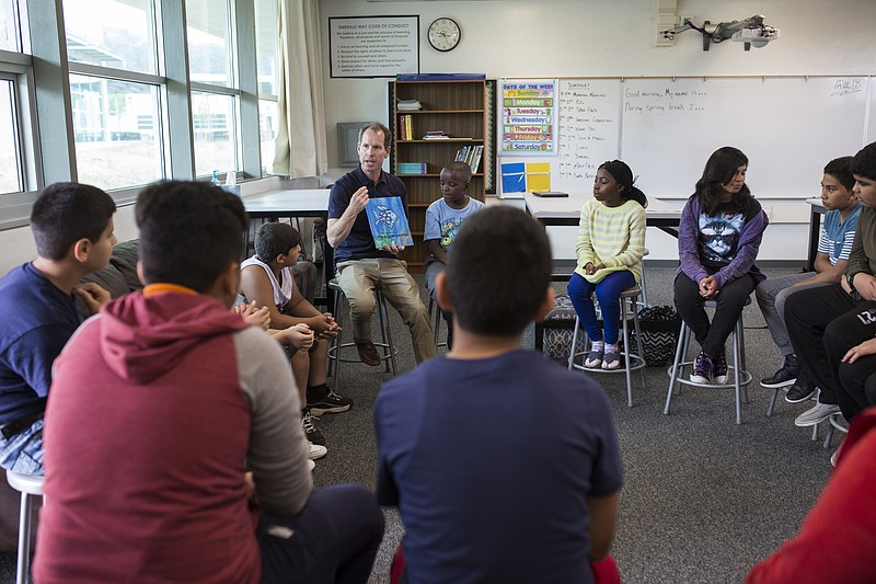 Teacher Christopher Baughman is shown working with students at Emerald middle...