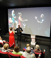Sleight-of-hand artist Jamy Ian Swiss performs a trick with volunteer PC members at the Digital Gym Cinema.