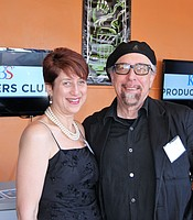 KPBS Arts and Culture Reporter Beth Accomando with sleight-of-hand artist Jamy Ian Swiss at the Digital Gym Cinema.