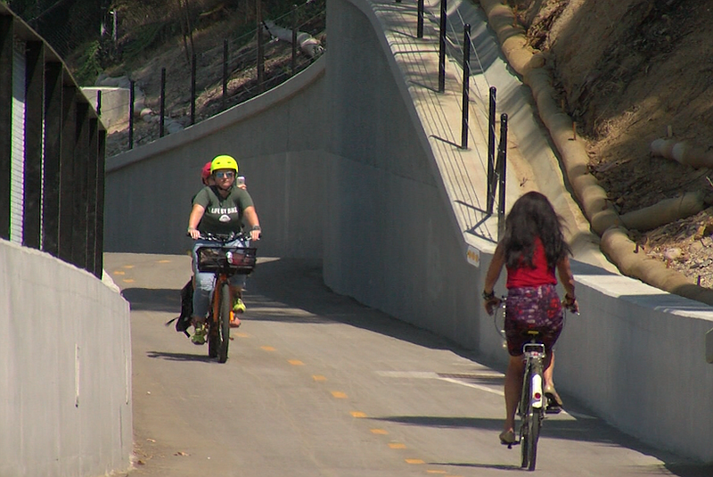 Bicyclists ride on the SR-15 commuter bikeway between Kensington and Mission ...
