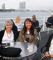 PC members Kathy Florendo and Tran Lin with KPBS Planned Giving and Major Gifts Manager Vien Nguyen aboard the Hornblower cruise ship.