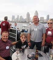 PC members David Boetsch and Mark Parikka with his nephew and All Things Considered KPBS news anchor Sally Hixson aboard the Hornblower cruise ship.