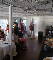 """All Things Considered"" KPBS news anchor Sally Hixson gives remarks aboard the Hornblower cruise ship."