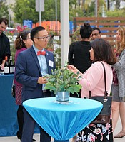 KPBS Director of Development Alex Kim mingles with guests at the Rady Children's Hospital.