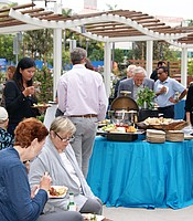 KPBS Producers Club members and guests enjoy light hors d'oeuvres at the Rady Children's Hospital.