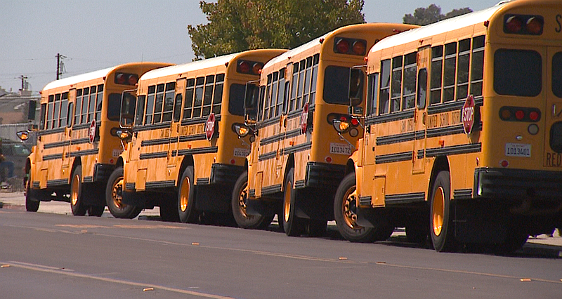 School buses are parked outside Woodrow Wilson Middle School in City Heights,...