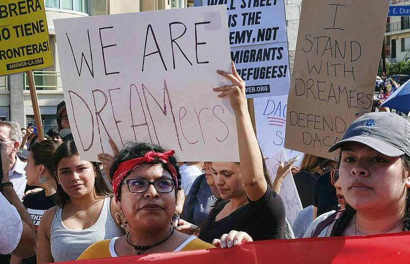 Supporters of the Deferred Action for Childhood Arrivals, or DACA chant sloga...