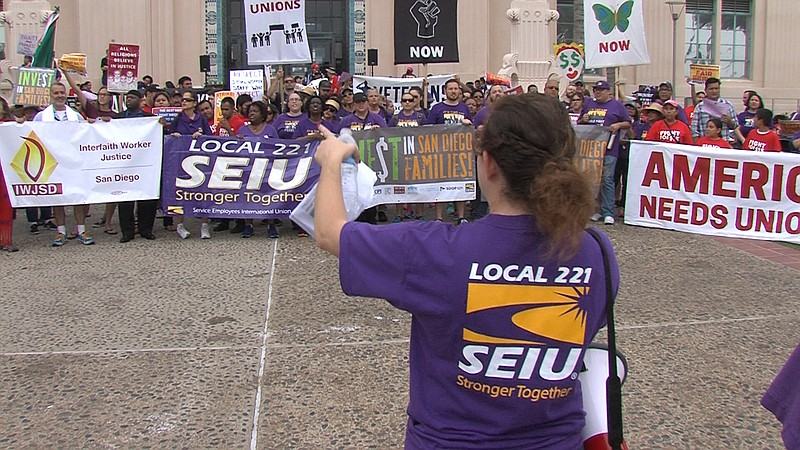 SEIU Local 121 members gather at a worker's rights demonstration on Labor Day...