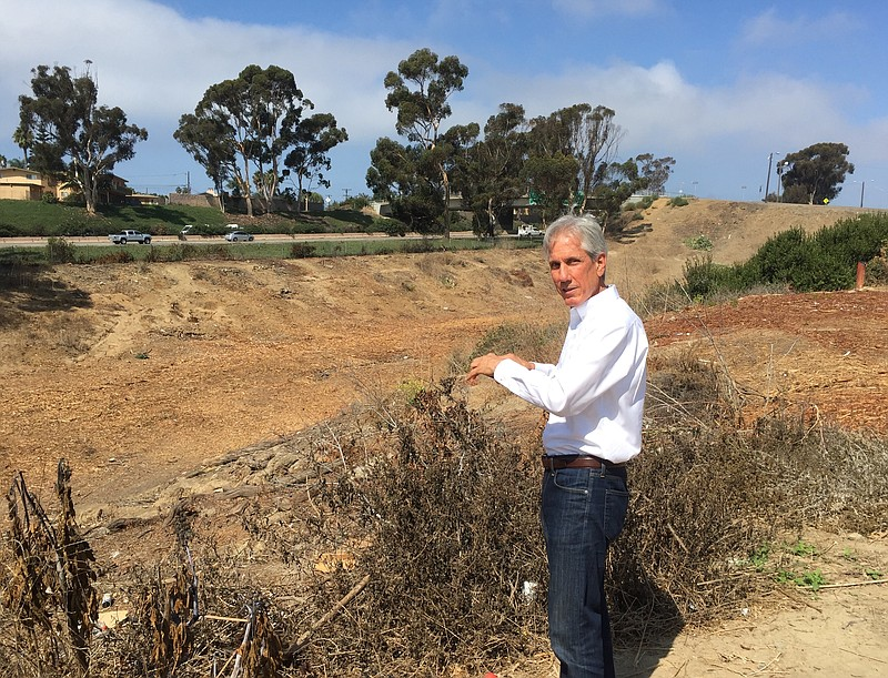Oceanside Deputy Mayor Chuck Lowery surveys a section of the canyon near Inte...