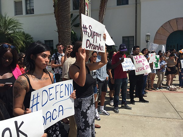 Students gather outside Hepner Hall at San Diego State Un...
