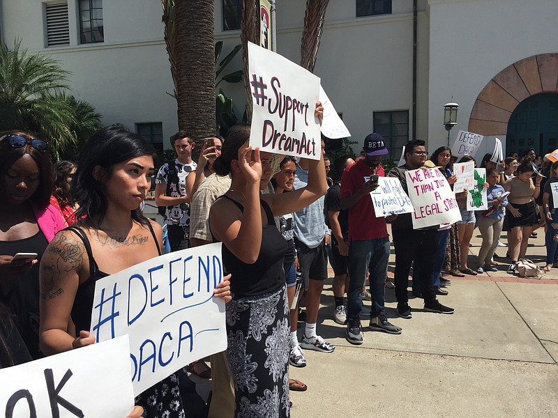 Students gather outside Hepner Hall at San Diego State University to rally in...