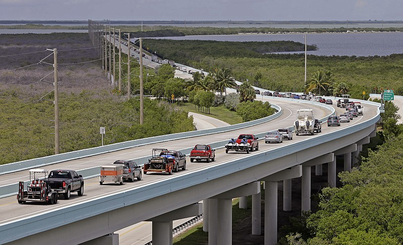 Motorists head north of Key Largo, Fla., on US 1, in anticipation of Hurrican...