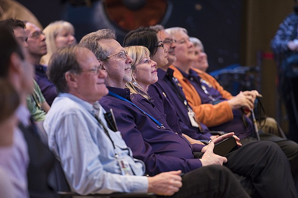 Team members and guests at JPL awaiting news about the Ca...