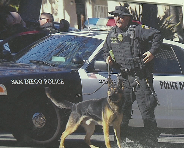 A photograph of San Diego Police canine handler Larry Ada...