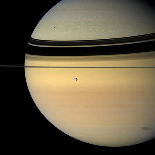 One of Saturn's moon casting shadow on the planet.