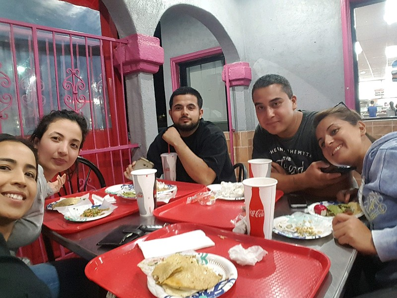 From left: Carmen, Maria, Pablo, Felipe and Izabel Solis eat tacos in Chula V...