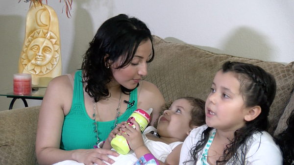 Maria Solis Jason plays with her daughters in North Count...