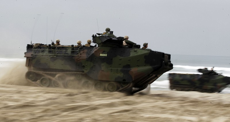 Amphibious assault vehicles deliver U.S. Marines to the beach during operatio...