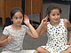 Second-graders at Meridian Elementary School dance to a song about listening,...