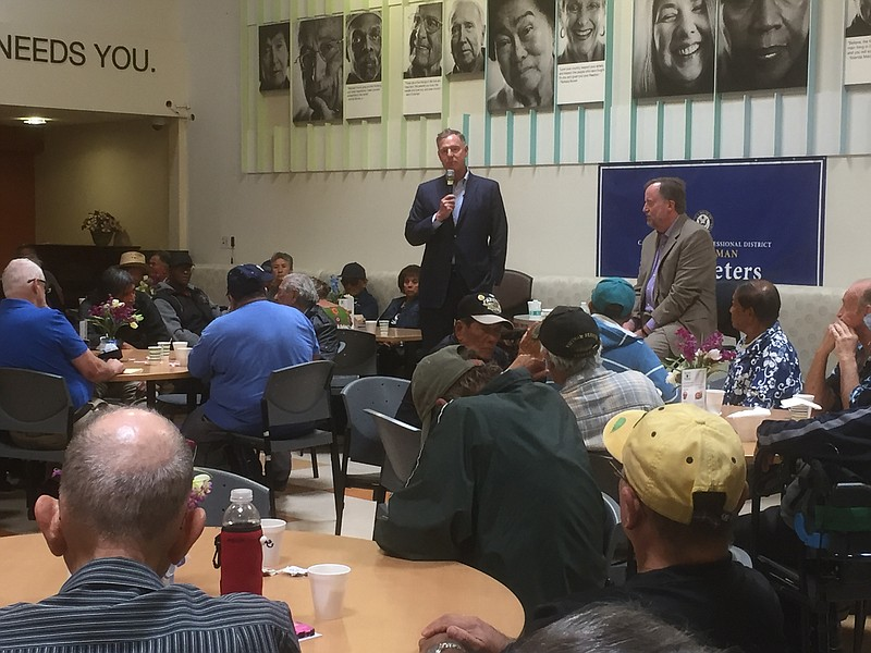 Rep. Scott Peters (D-San Diego) talks to seniors at the Serving Seniors Cente...