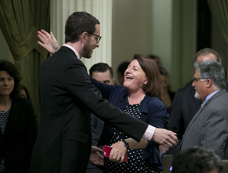 State Sen. Toni Atkins, D-San Diego, receives congratulations from Sen. Scott...