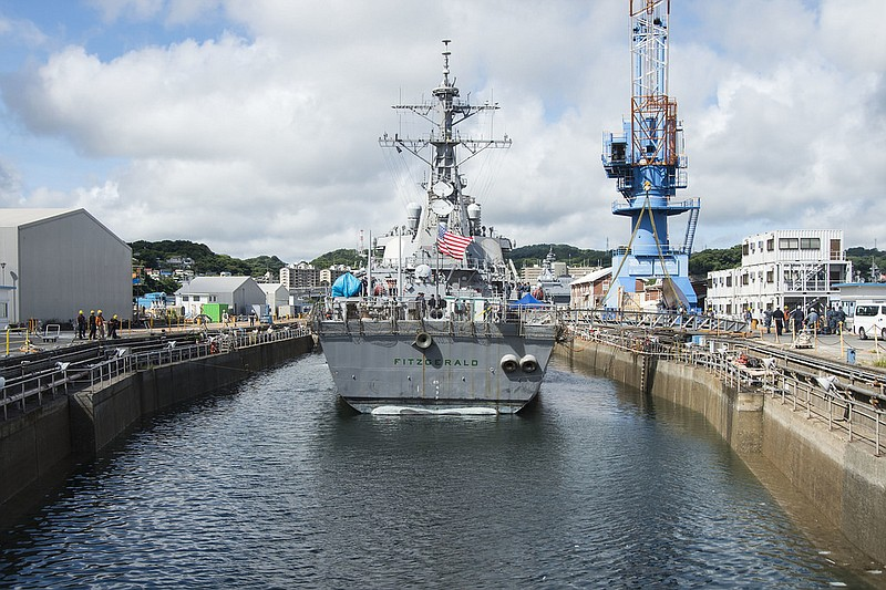 Arleigh Burke-class guided-missile destroyer USS Fitzgerald (DDG 62) is posit...