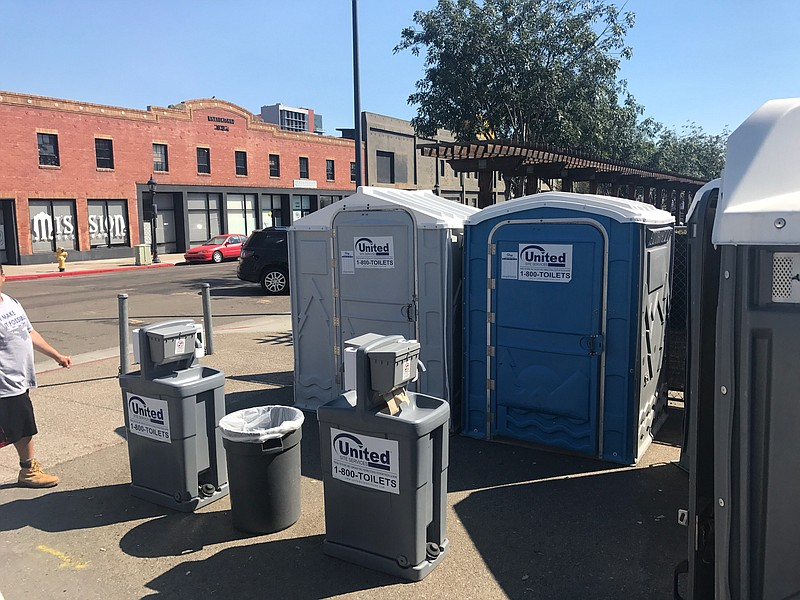 Public restrooms and a handwashing station aimed at curbing the spread of a h...