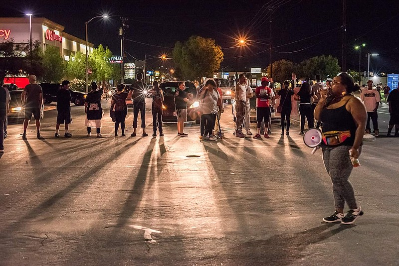 Wilnisha Sutton leading demonstrators as they block traffic in El Cajon Sept....