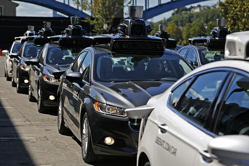 A group of self-driving Uber vehicles, Monday, Sept. 12, 2016.