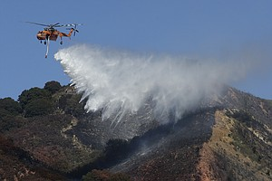 Southern California Residents Head Home As Crews Tame Fire