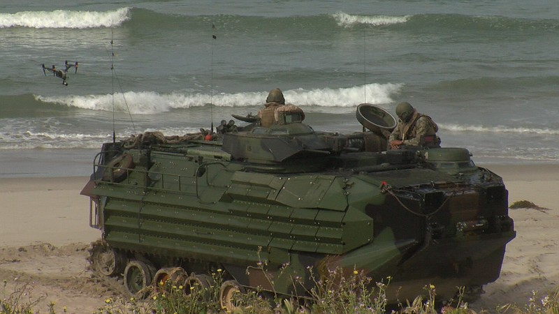 A Marine Amphibious Assault Vehicle comes ashore at Red Beach during a spring...
